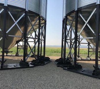 PIcture of hopper bins spaced apart on Steel skid